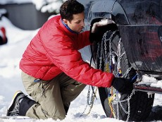 Man fitting snow chains